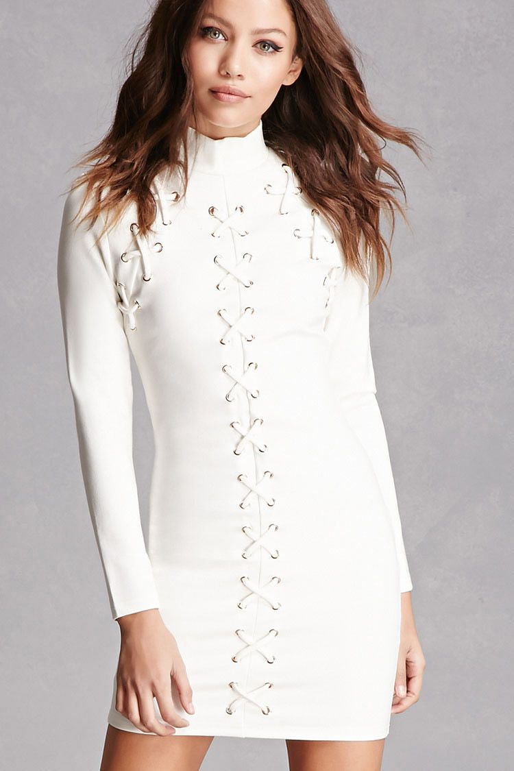 This midweight knit mini dress features a bodycon silhouette laced