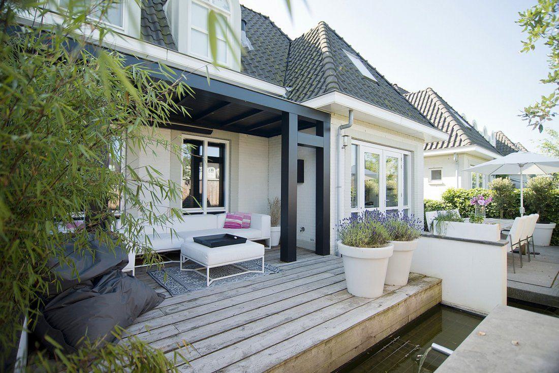 Perfecte Midsommar Tuin : Buytengewoon sfeervolle moderne stadstuin met veranda