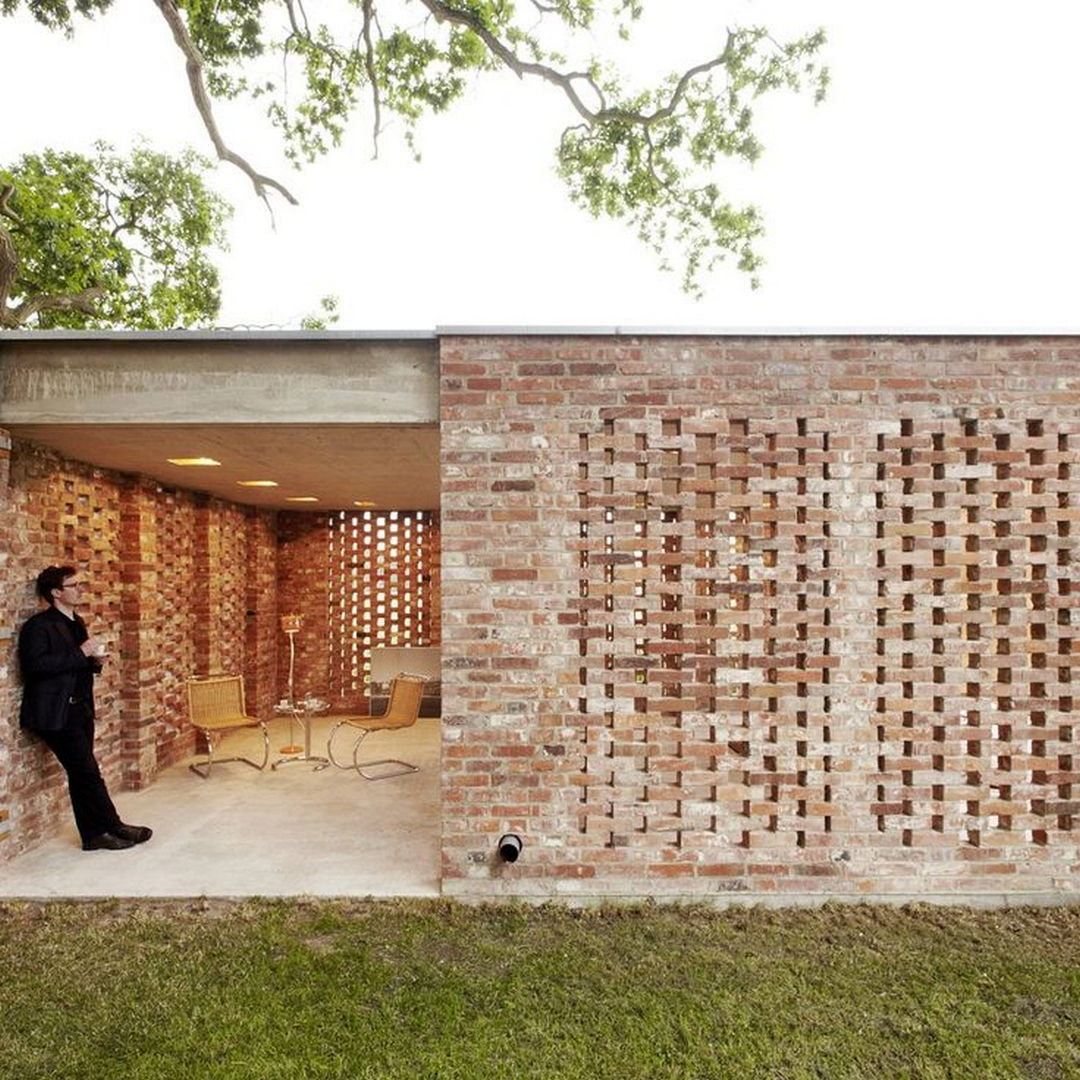 Bjerkealleen A Compact Rectangular House With A Red Painted Wooden Cladding On Brick Base Brick Architecture Pavilion Architecture Facade House