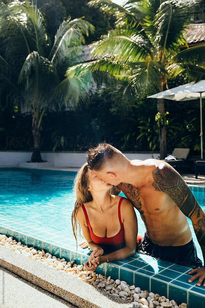 Sexy couple standing in the pool on holidays in slow motion