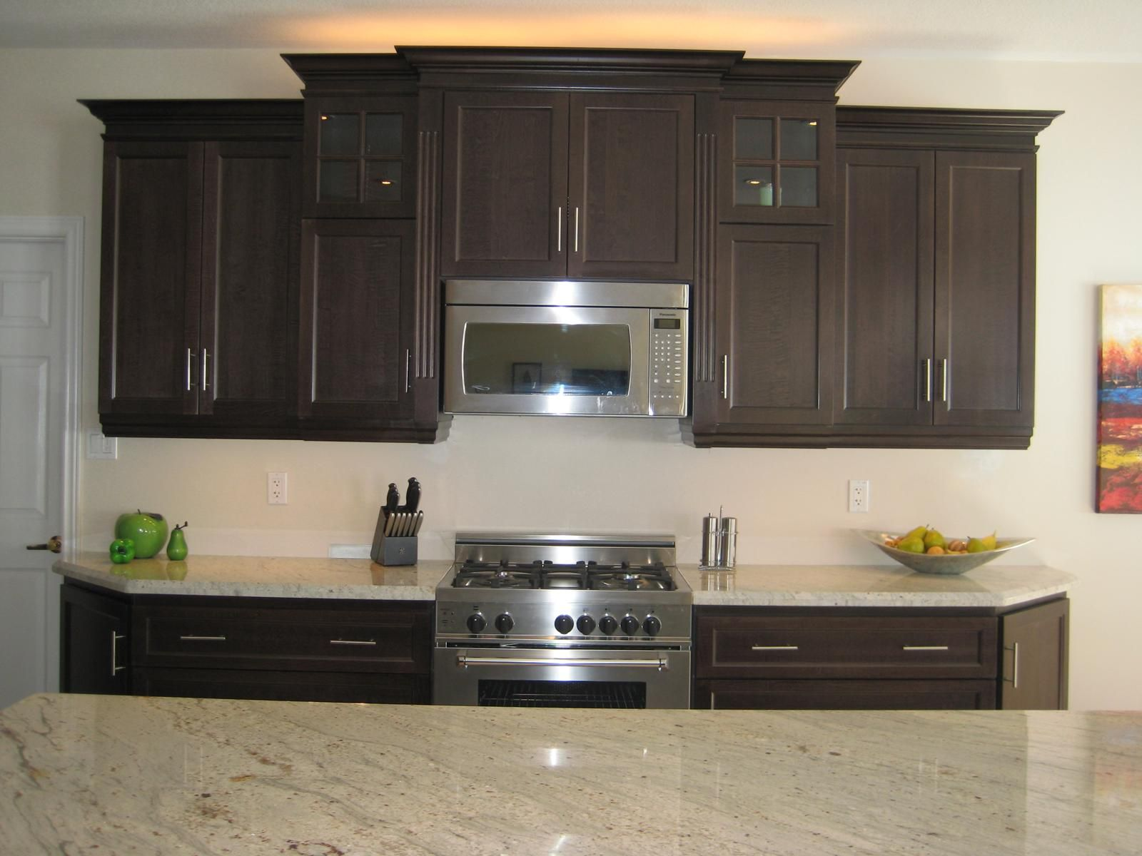 Kashmir white granite dark cabinets roselawnlutheran for Pictures of white kitchen cabinets with granite countertops