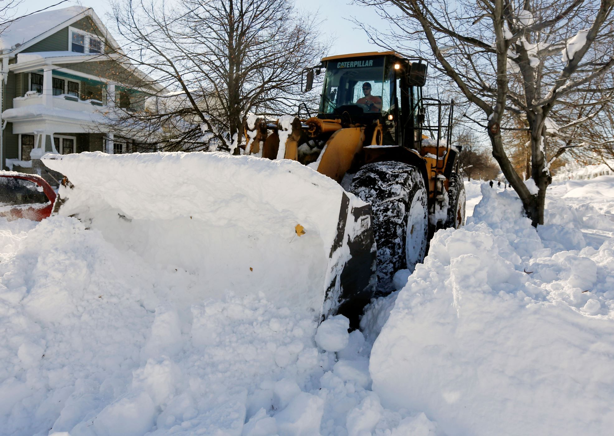 Cold and snow roll across the country. A front loader