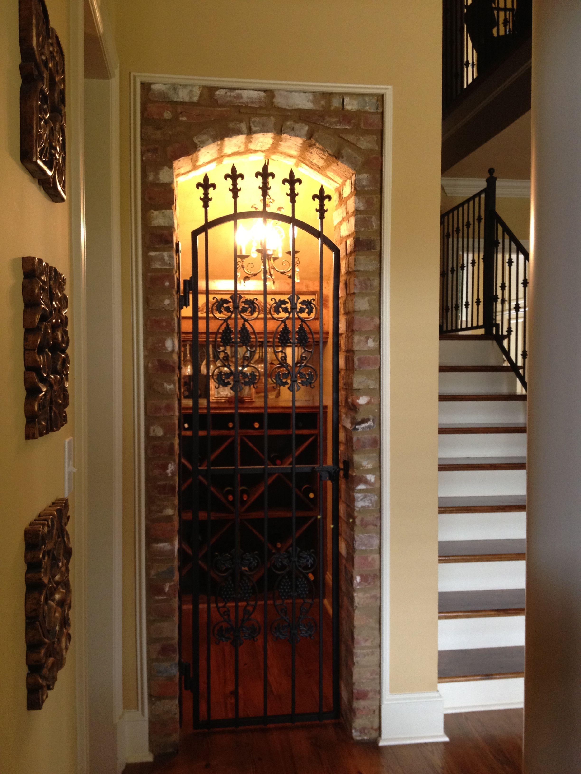 Wine cellar wine closet under stairs wine closets for Dining room closet ideas
