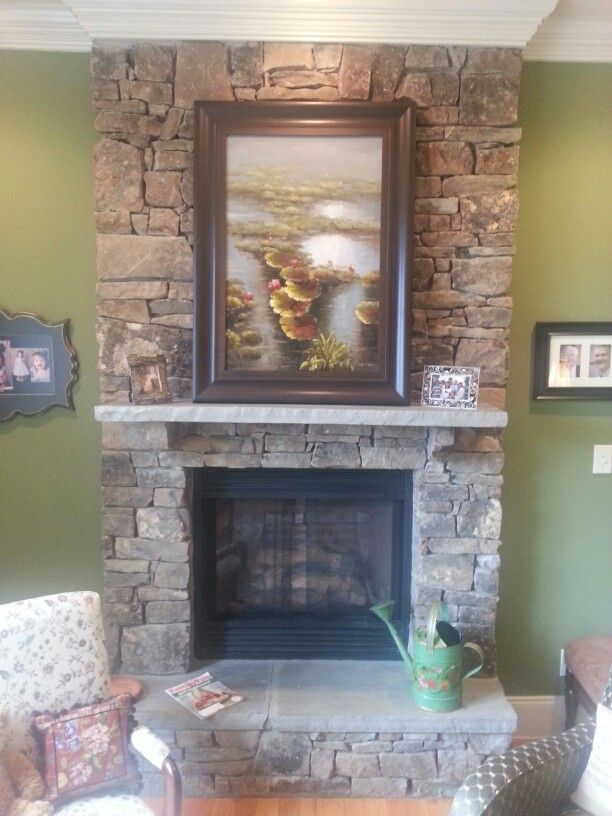 Full height stone fireplace with raised hearth don t want