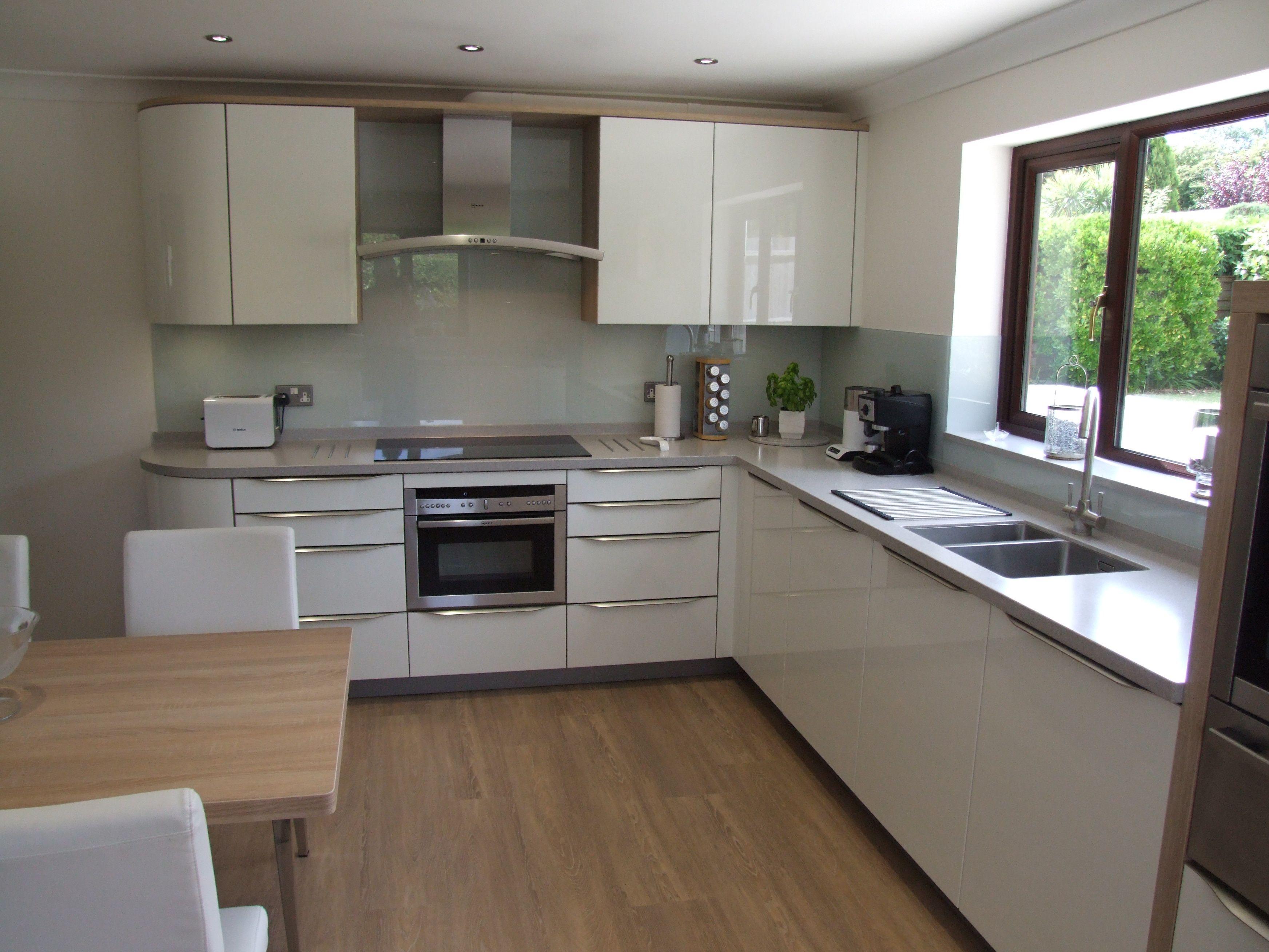 White gloss kitchen with warm oak framework matching for Warm kitchen flooring