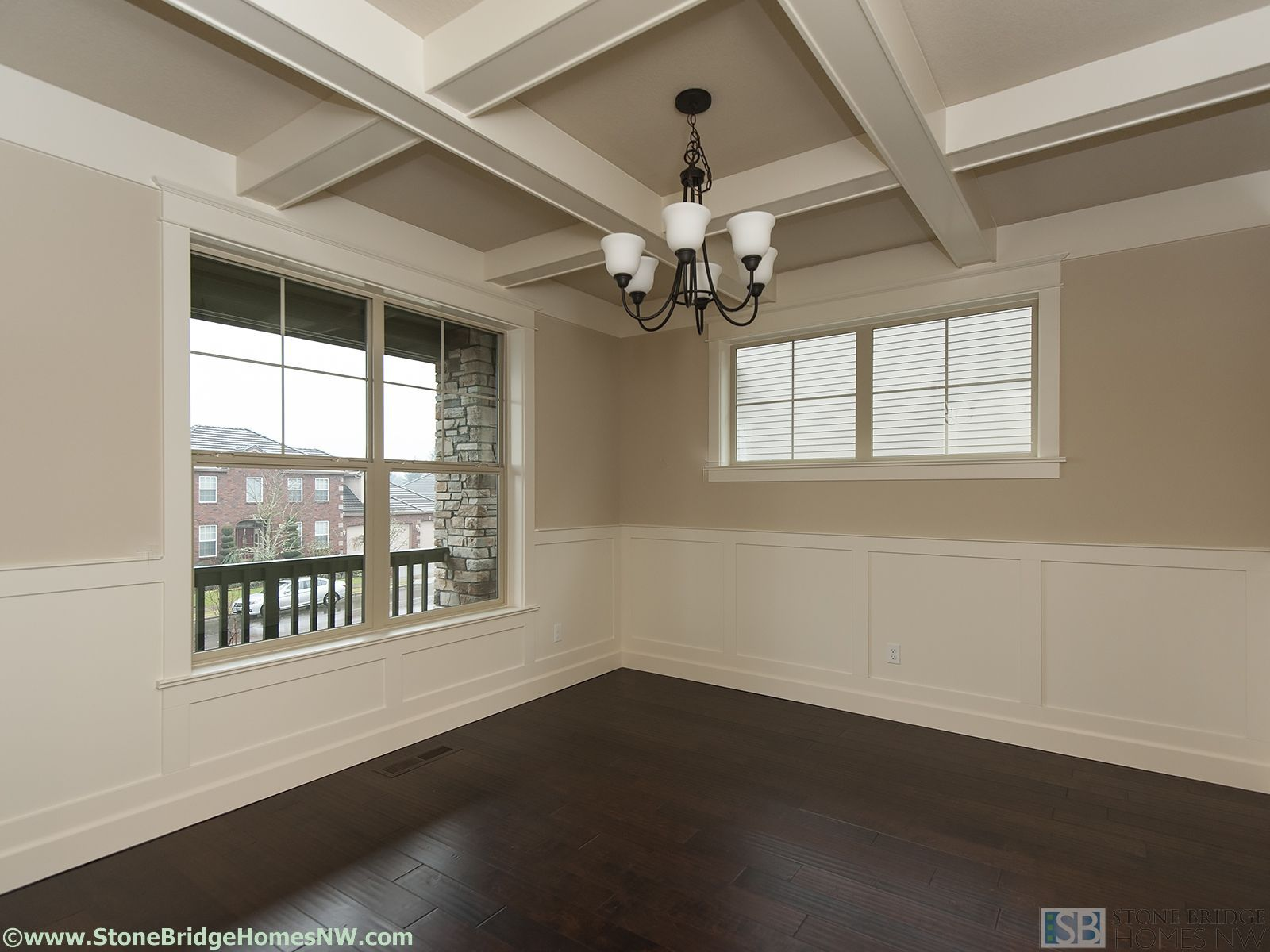 Dining room with wainscoting/wall paneling and coffered
