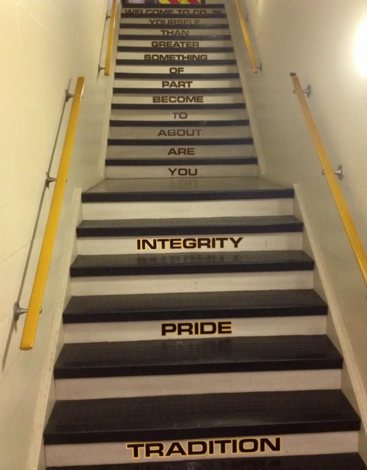 Stairs at Fire Station 16 painted with words Tradition, pride, integrity