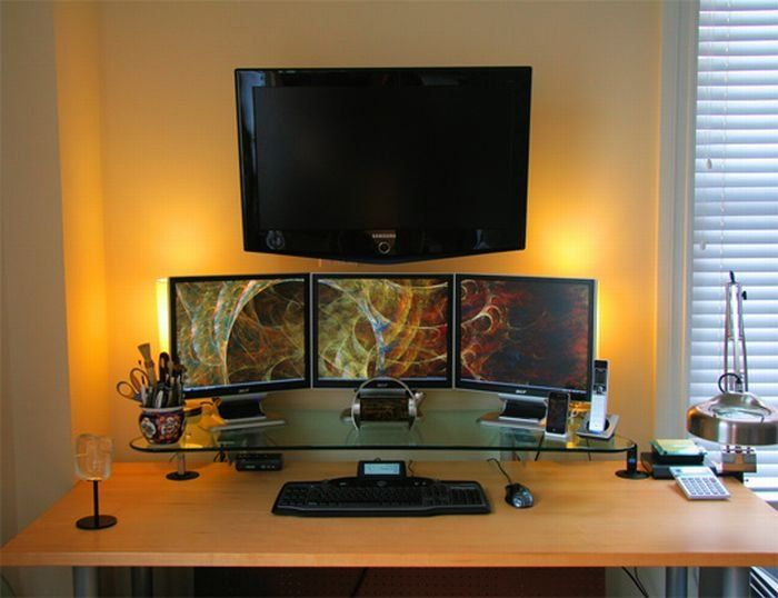 Three monitors and flat screen TV - neat set up | Home ...