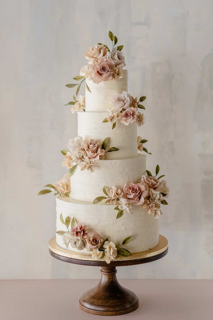 Beautiful 4 tier wedding cake with floral appliques by Winifred kriste cake   Lace Wedding Cake Ideas