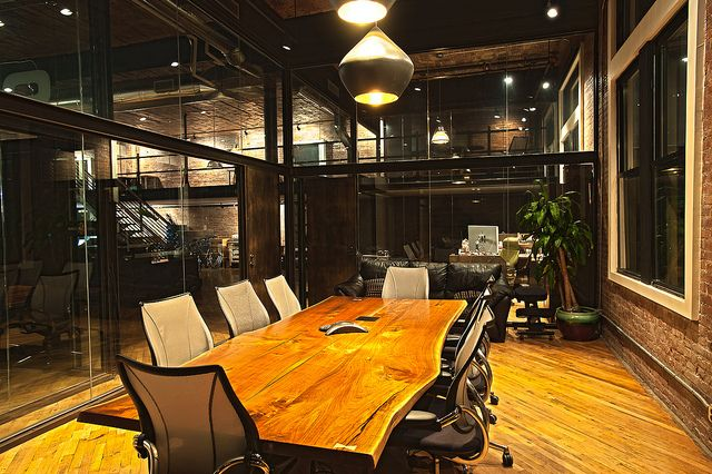 9mmedia 9mmedia is a software design company with an incredible office featuring a lot of wood, metal, and glass. A key goal of the NYC office is to combine privacy and intimacy for their team of developers – each of whom has a large work area.