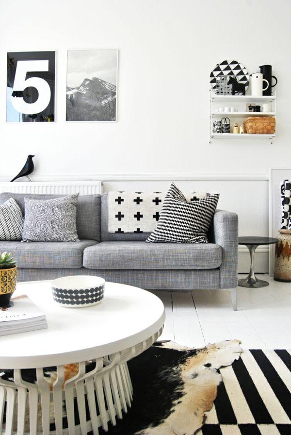 Hellgraues Sofa vintage einrichtung weißer couchtisch fellteppich hellgraues sofa