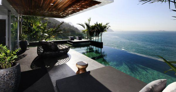 A Spectacular 5 Bedroom Villa For Sale in Joa, Beautifully Designed and Covering 800m2, Infinity Pool, BBQ Area, Vertical Garden, and Private Security.