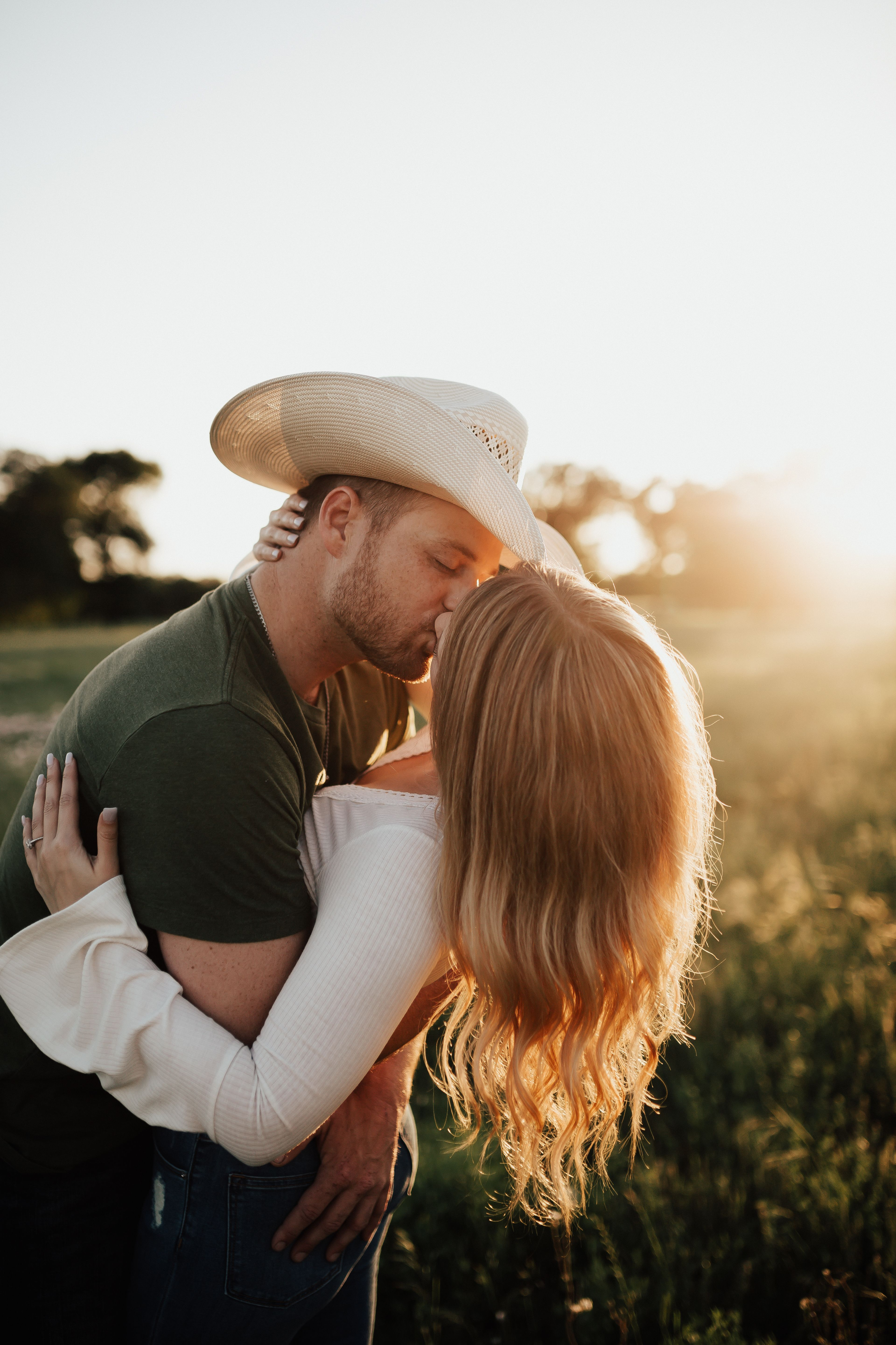 Texas Sunset Engagement Session // Country Couple -  Loved shooting with this gorgeous western couple out in a random field near our Texas Ranch. #field - #COUNTRY #couple #Engagement #EngagementPhotosafricanamerican #EngagementPhotosbeach #EngagementPhotoscountry #EngagementPhotosfall #EngagementPhotosideas #EngagementPhotosoutfits #EngagementPhotosposes #EngagementPhotosspring #EngagementPhotoswinter #EngagementPhotoswithdog #Session #summerEngagementPhotos #sunset #Texas #uniqueEngagementPho