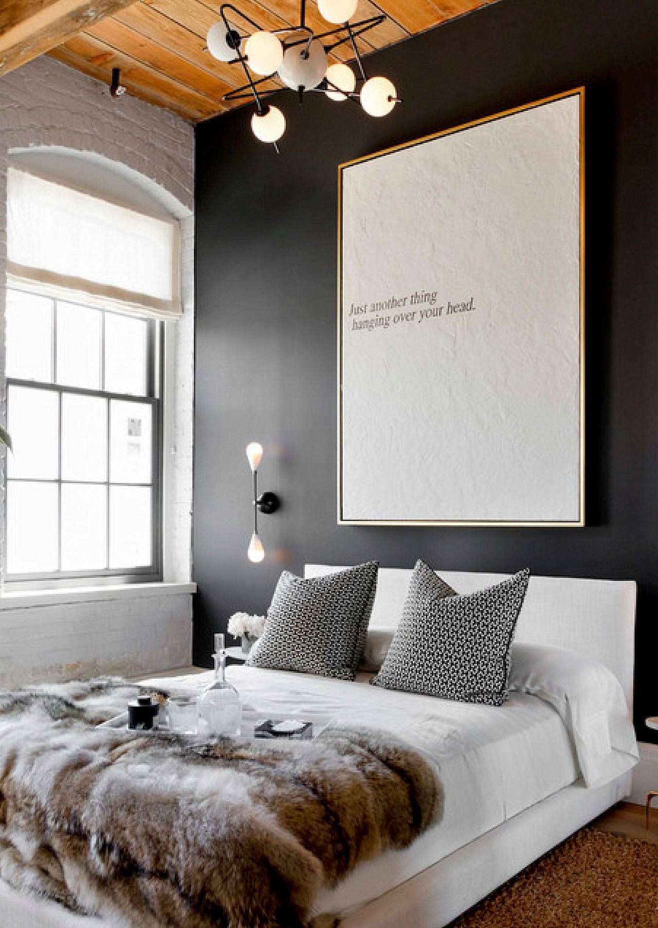 """I love the dark wall the artfully framed quote """"just another thing hanging over your head"""" and the lighting on the side & overhead"""