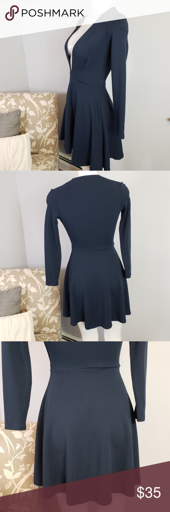 8c79937ec6 American Apparel navy deep v-neck skater dress Like new! American Apparel  navy blue long sleeve skater dress. Deep v-neck. Stretchy 60% rayon