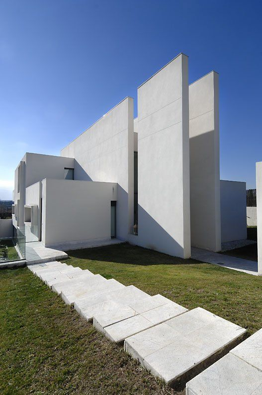Minimalist house white exterior facade at the camarines for Minimalist white house