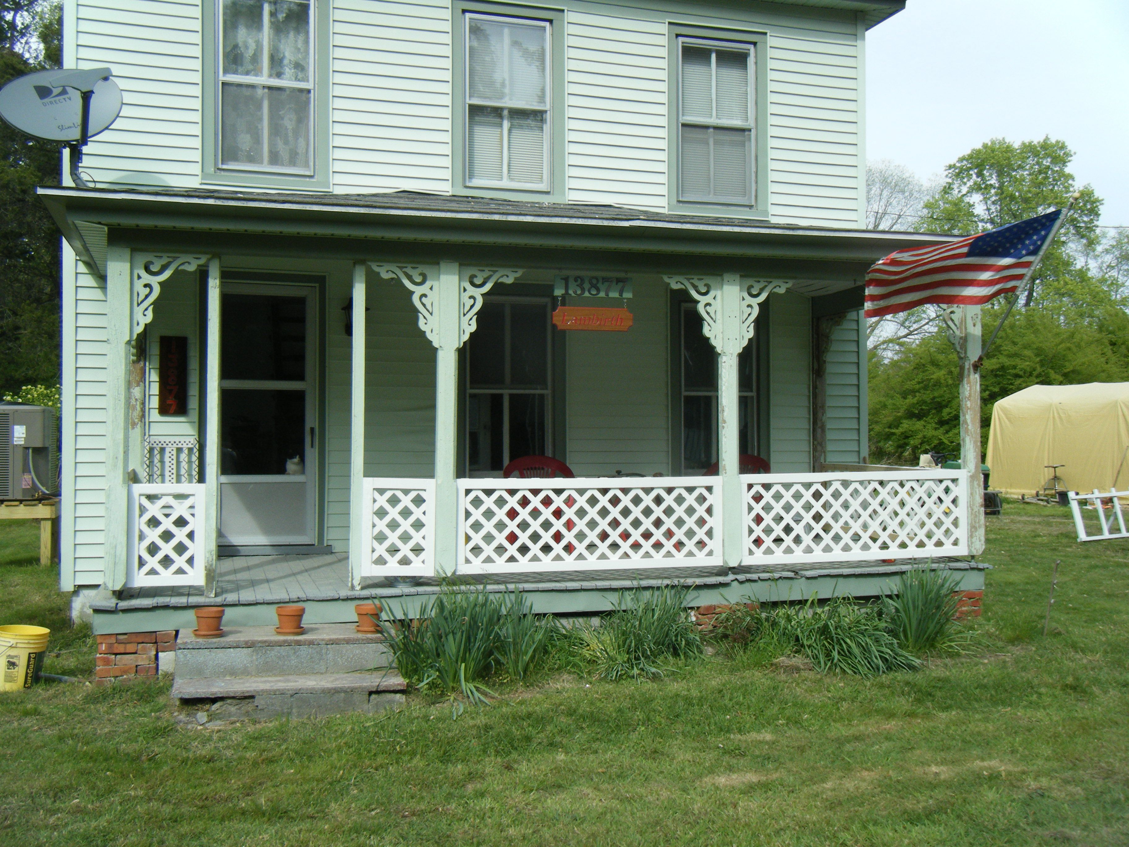 EASY railings around the porch. Lattice and 1x3 frames ...