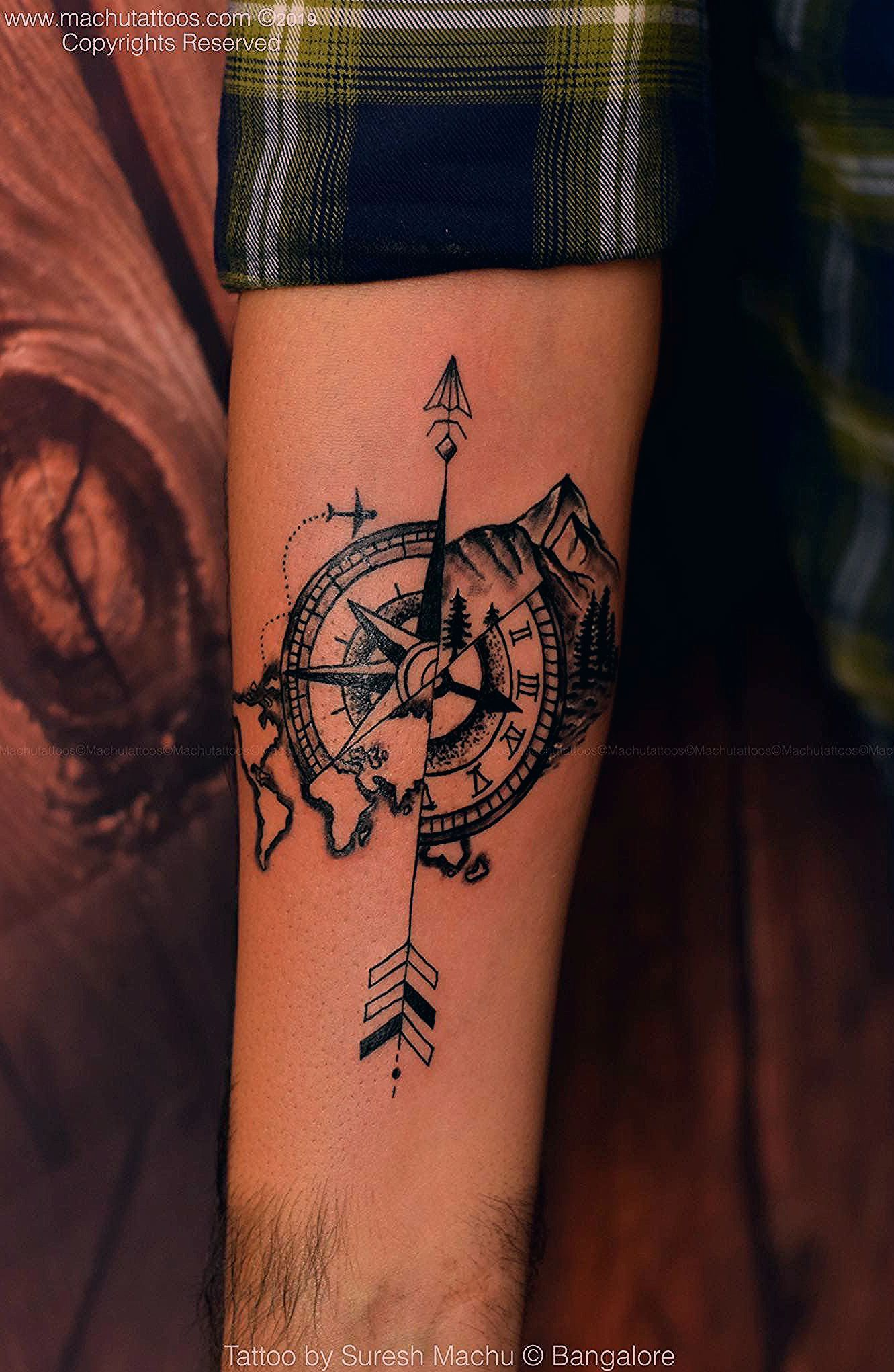 Photo of Travel tattoo   compass mountain world map tattoo