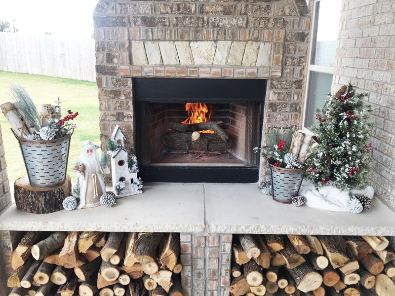 Rustic Christmas Decorations on an outdoor fireplace Outdoor