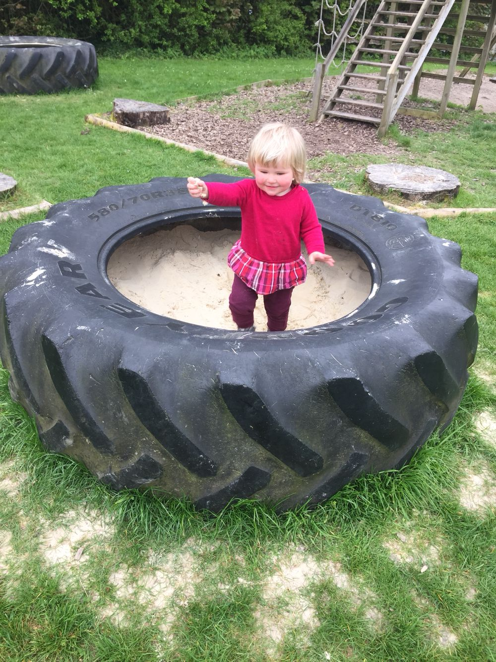 Old tractor tyre is a great sandpit outdoor chill space for Old tyre uses