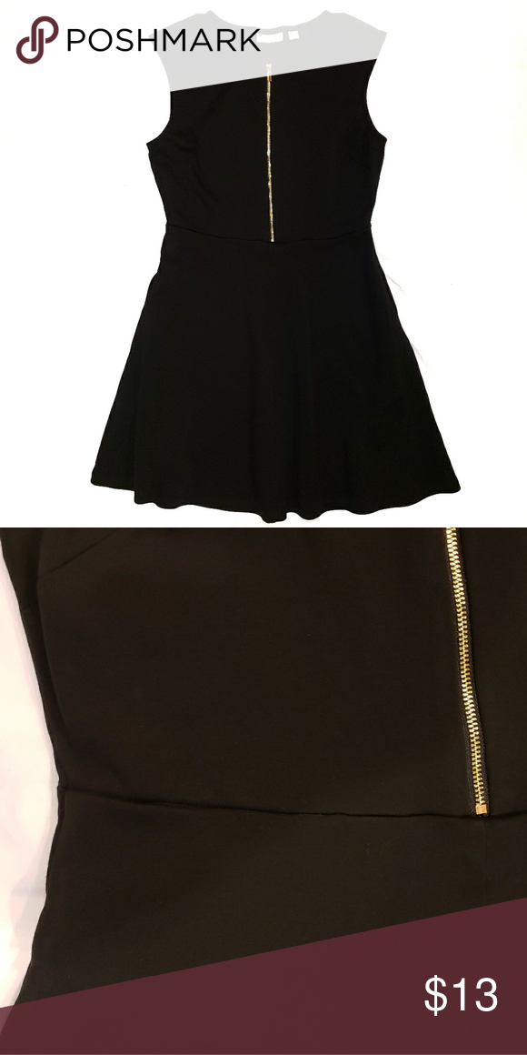 121bc72f1091 New York & Company dress This cute little black dress has a gold zipper in  the front and two side pockets. Pit to Pit: 17.5