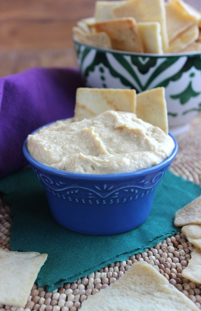 Roasted Garlic Hummus is pure flavor. You will want to eat this with a spoon or at least get some big scoops with your favorite veggies or chips. {❤︎ that pretty blue bowl} #hummus #garlic #dip