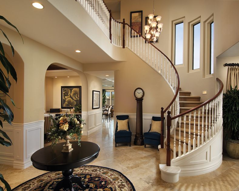 Foyer Window Price : Love the curved staircase and stepped windows