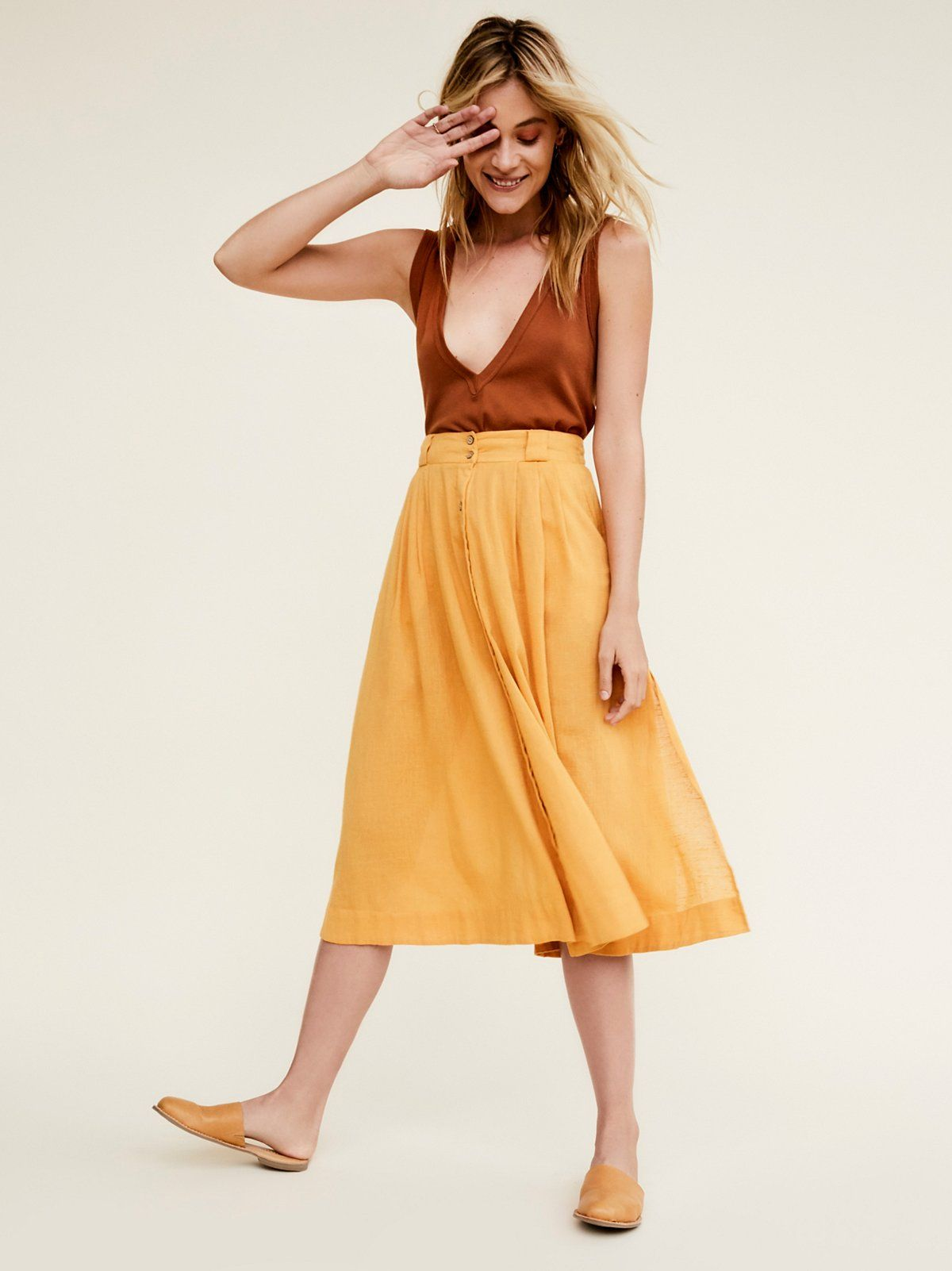 This That Skirt | Made from our sheer and gauzy Endless Summer fabric, this midi skirt features a buttonup front detail and high side slits for an effortless fit. Subtle pleating and hip pockets.