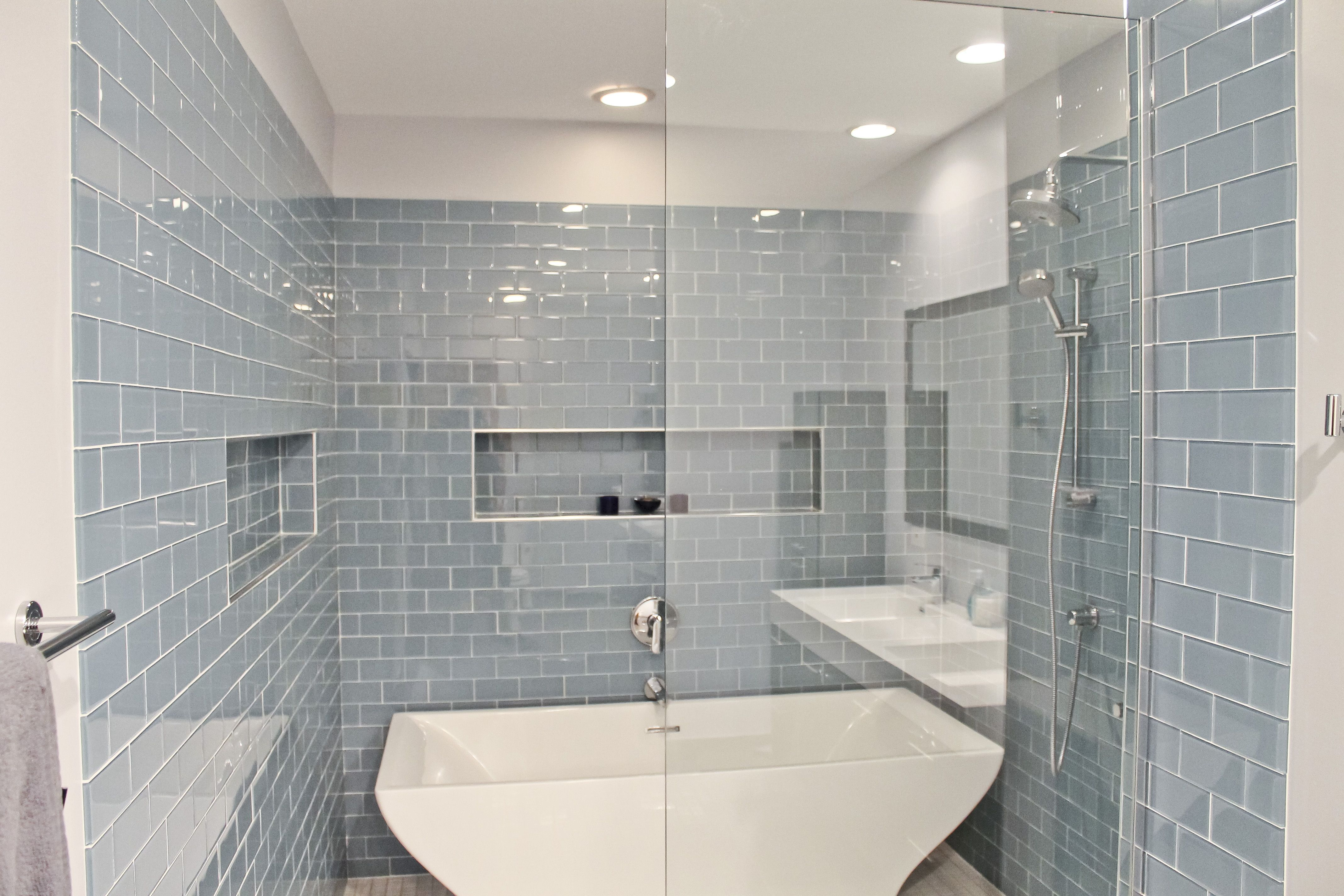 Complete kitchen bathroom attic and floor remodel of south loop contemporary master bathroom with vermeere ceramic tile ice blue gloss high ceiling handheld showerhead limestone counters doublecrazyfo Choice Image