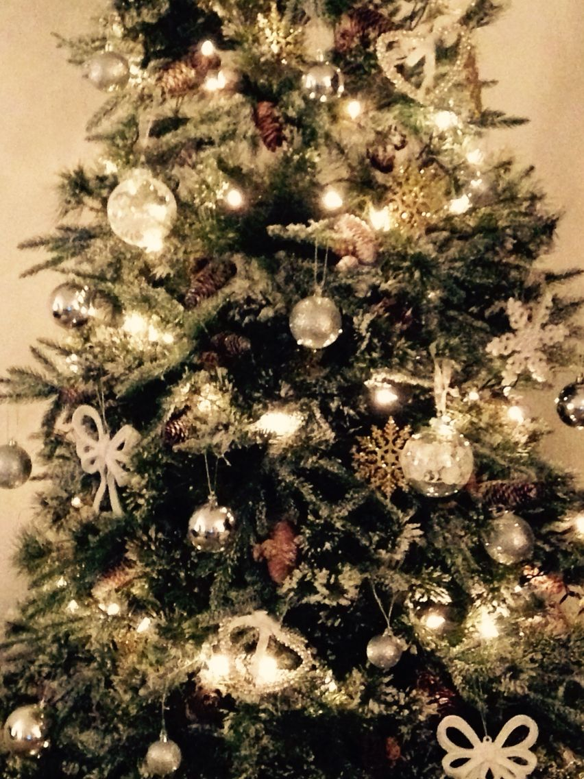 Beautiful gold silver and White Christmas tree, looks gorgeous In my living room