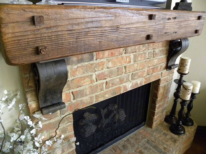 Wrought iron corbels look incredible beneath fireplace mantels ...