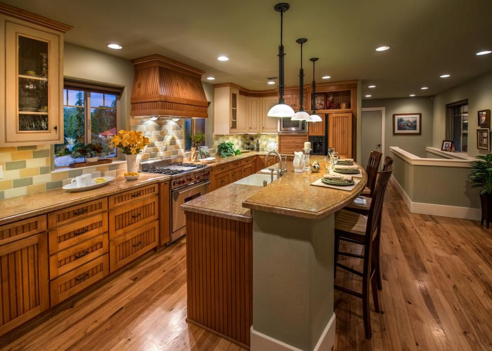 This green country kitchen features a large kitchen island