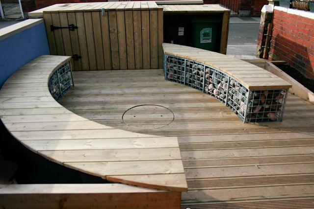 Curved gabion wall bench garden design leeds site for Landscape design leeds