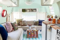 Custom flooring by http://graphicimageflooring.com/ via 9 Smart and Stylish Ways to Update an Old Travel Trailer  - CountryLiving.com