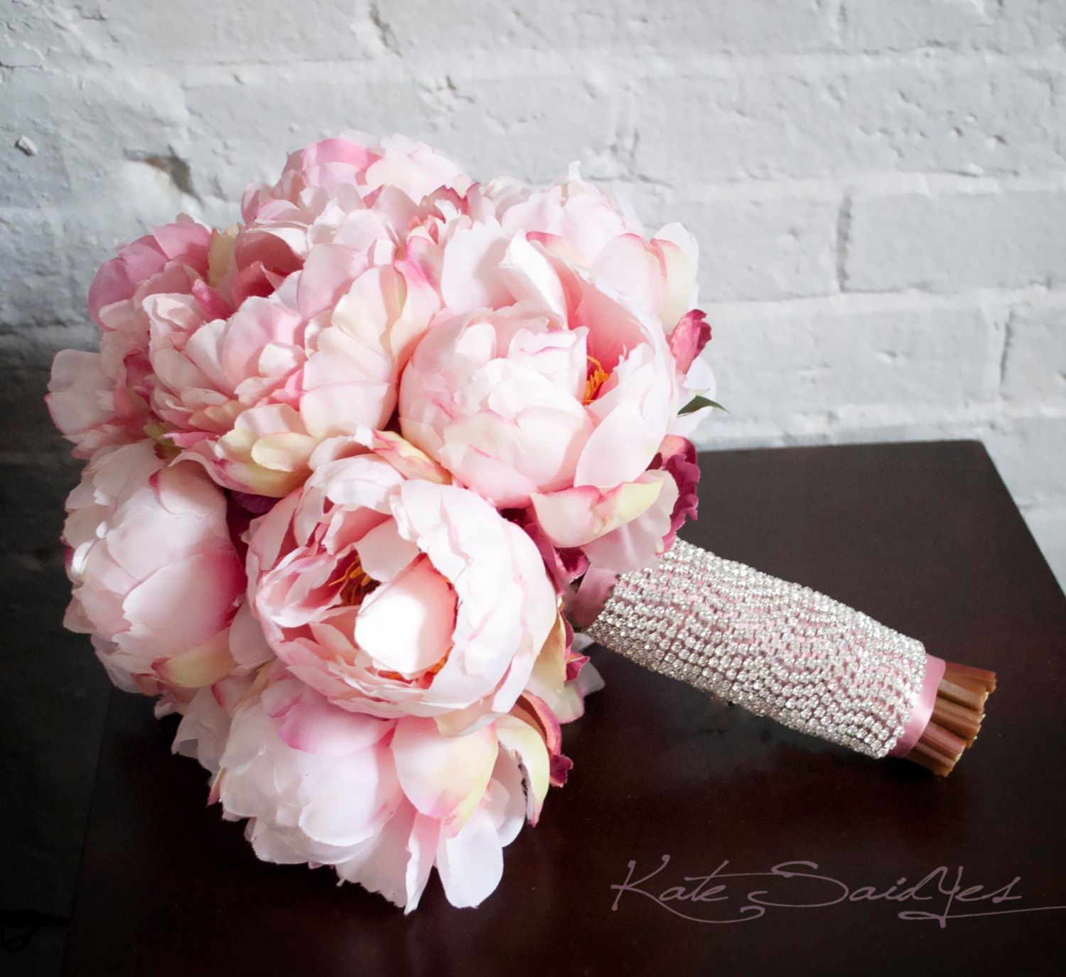 blush pink peony bouquet with rhinestone handle by