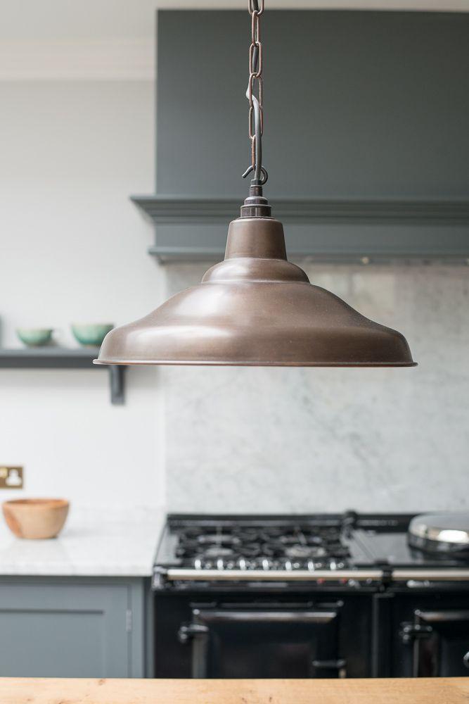 Beautiful pendant lights in devols hampton court kitchen