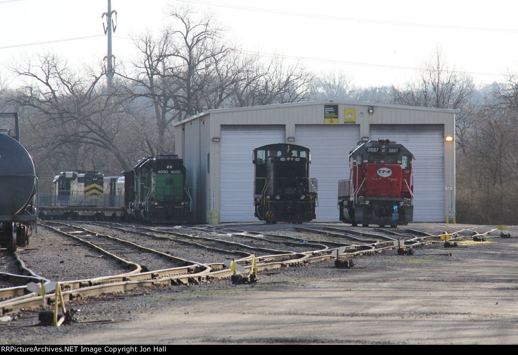 3887 & 2342 sit outside the shop as dead IORY power and the Cincinnati Railway's NKP 901 sit out back   Description:    Photo Date:  4/6/2014  Location:  Norwood, OH   Author:  Jon Hall  Categories:    Locomotives:  CFE 3887(GP38-2) CIND 2342(SW1500) IORY 4030(GP40) NKP 901(GP30)