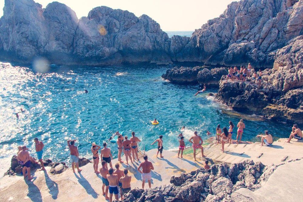 Sun umbrellas and deck chairs beach scene at Marina ...  |Capri Beach Scenes