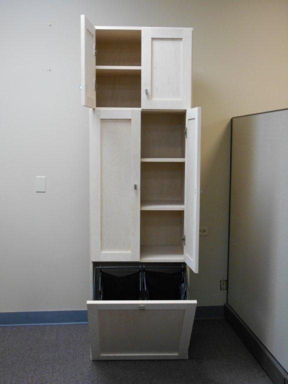 A Linen Cabinet With Lots Of Shelf Storage No Drawers And