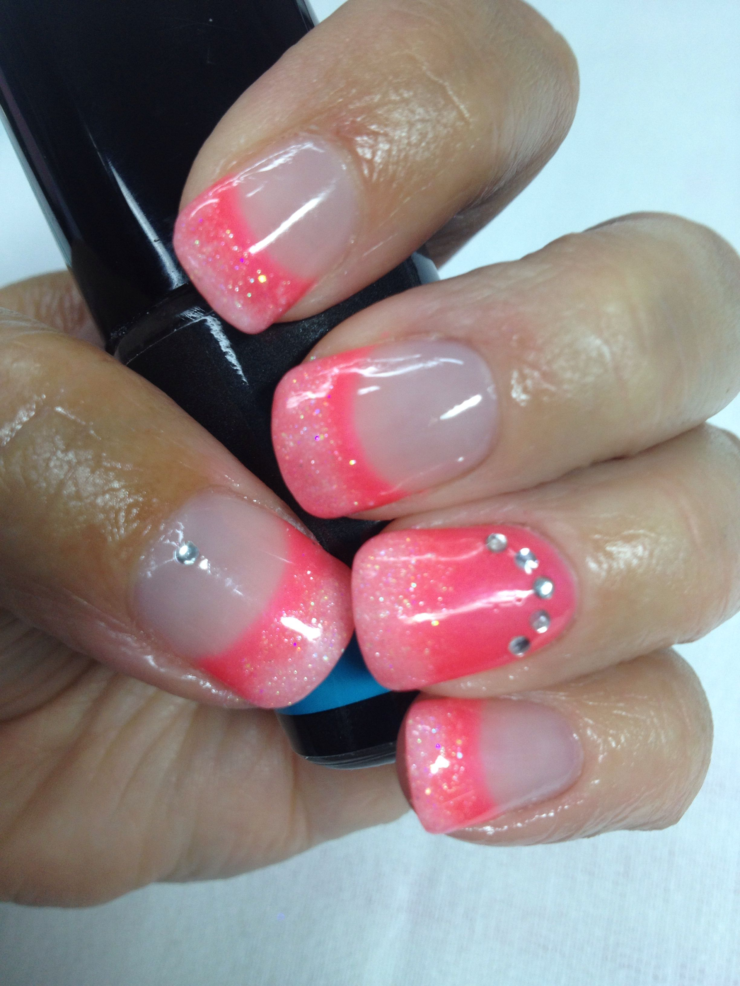 A bright neon pink/coral French gel nails with a whisper of white ...
