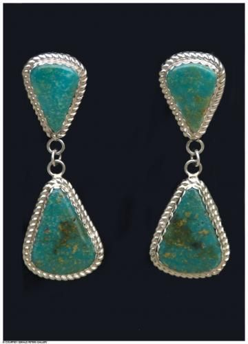 Jimmy Calabaza (Santa Domingo Pueblo), Manassa Turquoise Earrings, 2 1/4 x 3/4 x 3/16 inches each, sterling silver and turquoise. At the Gerald Peters Gallery, Santa Fe, NM.