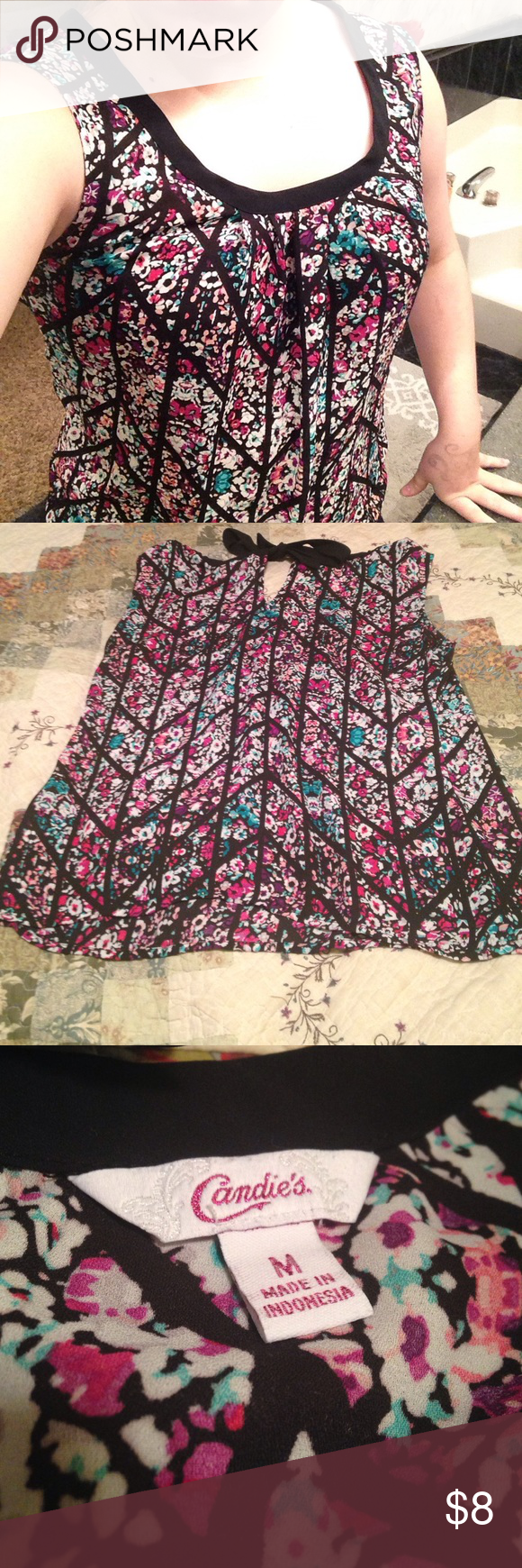 Gorgeous floral blouse. Size medium Floral blouse, with a bow at the nape of the neck on the back. It has been worn around two times. It is in great condition, practically no wear. Vibrant colors. The fabric is not stretchy. The tie at the back does allow for adjustment in the neck line though. Gorgeous, the pictures do not do it justice! The brand is candies. Candie's Tops Blouses
