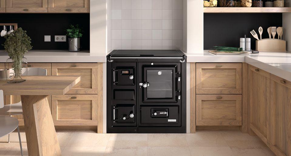 Hergom estufas hogares y chimeneas de hierro fundido for Cocina lena calefactora