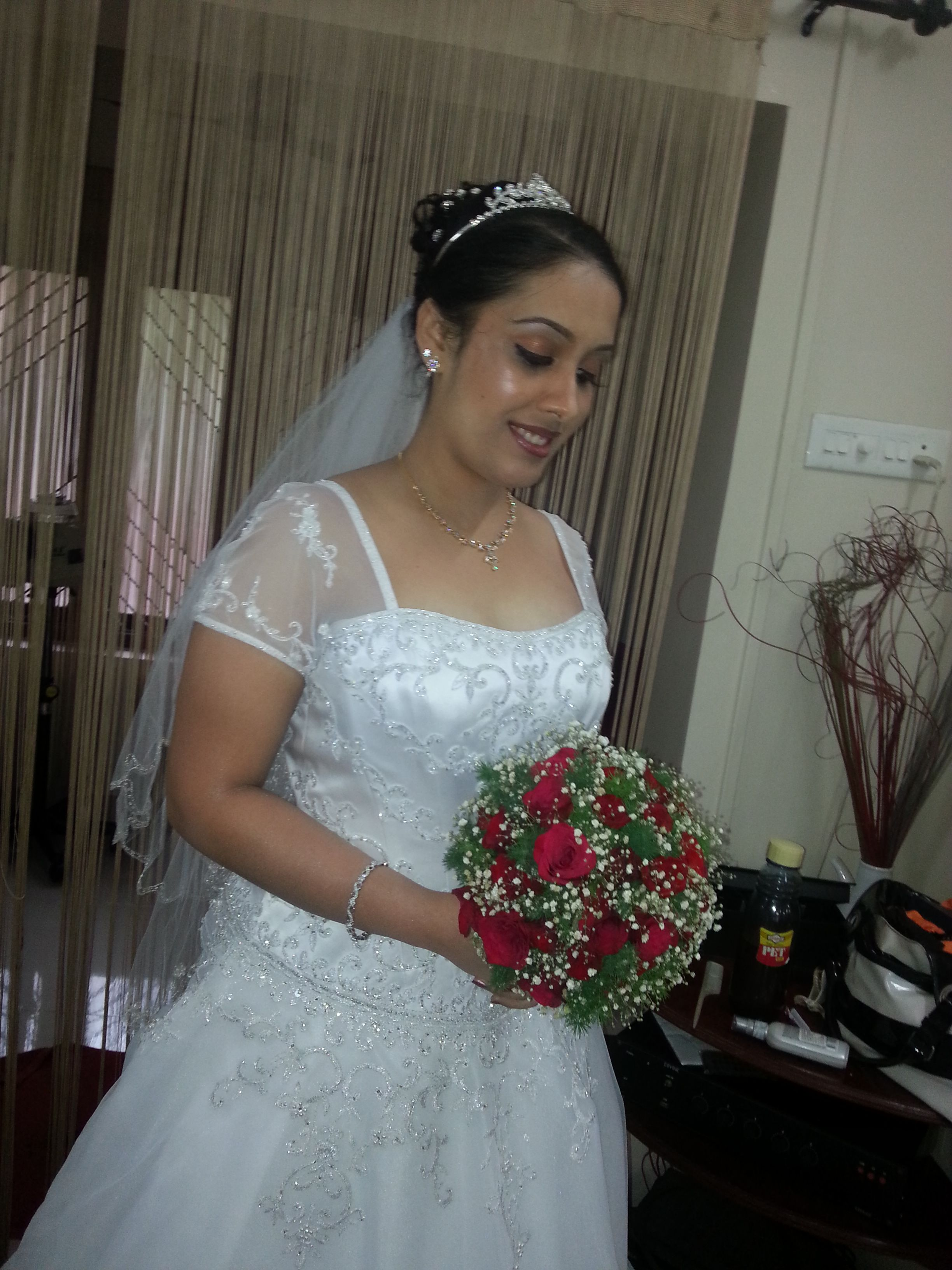 This White Wedding Dress Works Well For A Kerala Christian Bride
