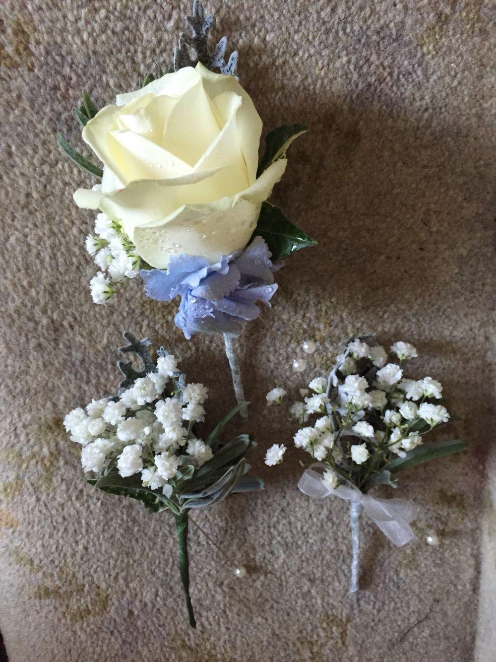 Ivory rose and gypsophelia buttonholes