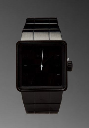 NIXON - The Quatro I have this in stainless steel