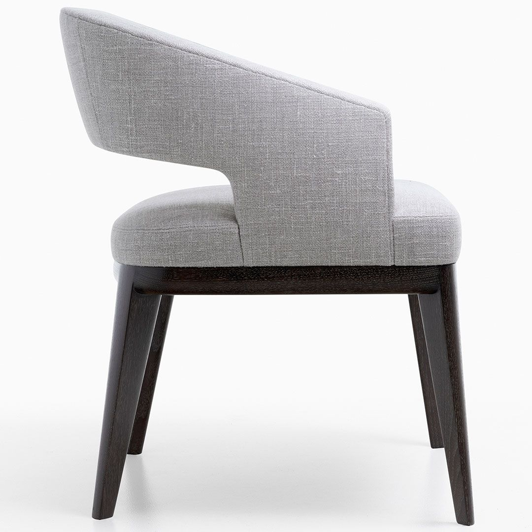 The Minerva Dining Chair Alluring Curves Are A Harmonious Blend Of