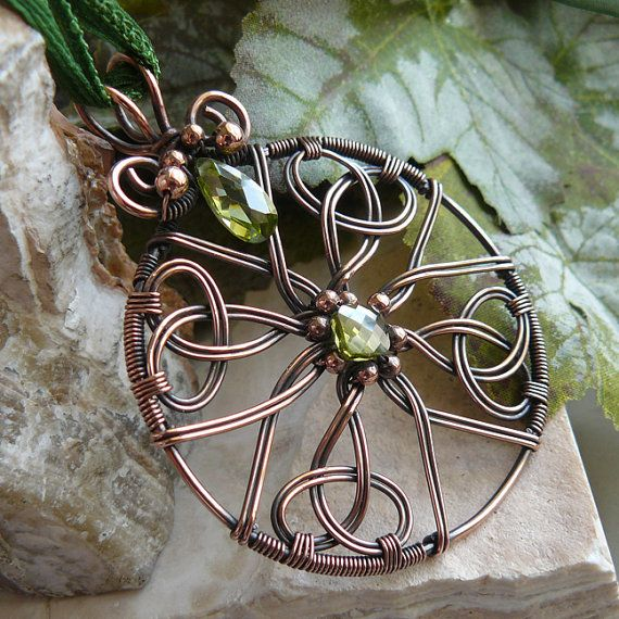 Kell's Creations - This is a copper wire Celtic knot pendant with olive cubic zirconias.