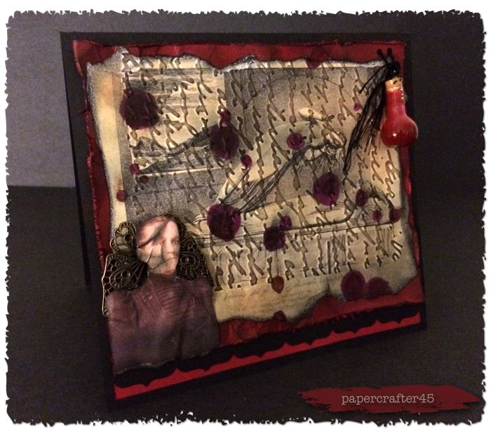 """Haunted Design House - Macabre Monday Challenge 180 - Fresh Blood - Card created by papercrafter45 using images courtesy of The Graphics Fairy; """"Script"""" embossing folder; black & """"Shades of Red"""" cardstock from Recollections; """"Upper Crest"""" border punch from Fiskars; """"Vintage Photo"""" & """"Black Soot"""" distress inks, """"Tea Dye"""" reinker, and """"Wild Plum"""" alcohol ink from Ranger; metal filigree butterfly; black embroidery floss; and hand-poured resin """"blood"""" vial [GRUESOME TWOSOME CHALLENGE WINNER…"""
