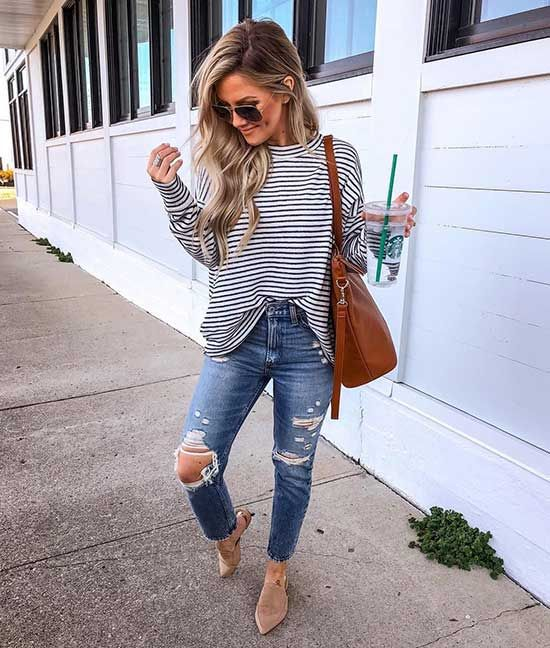 Casual spring outfit with a striped, oversized sweater and skinny ripped jeans and …